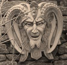 Garden ornament of the horned god Cernunnous, the Green Man.